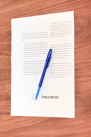 contract insurance, blue pen for signing, close-up