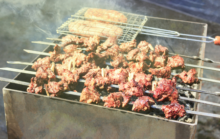 The most delicious sausages, appetizing shish kebab from fresh meat shish kebab , grilled from charcoal, outdoors.