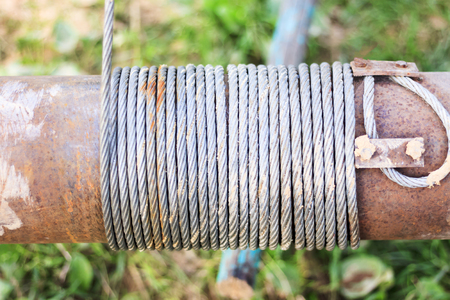 metal rusty retro hand winch. close-up. The photo was taken on a cloudy day.