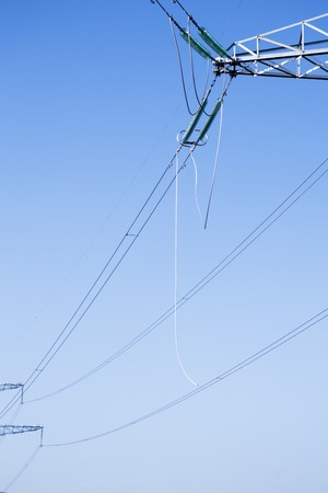 high voltage power lines. horizon line is wrong. electrical distribution station.