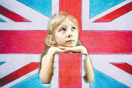 Little girl blonde, stack of books, flag of the United Kingdom, double exposure, there is toning. Archivio Fotografico - 115333514