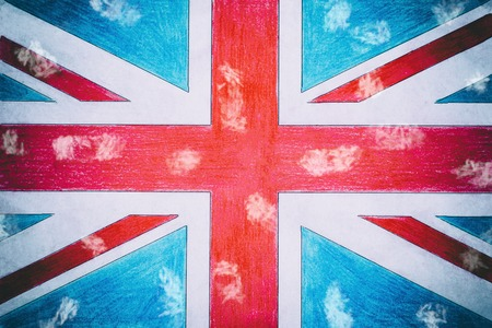 United Kingdom flag on paper, wooden background in old style. there is toning.