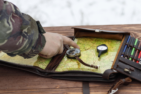 Winter is snowing. Combat training. determine the military route on the map. there is toning.