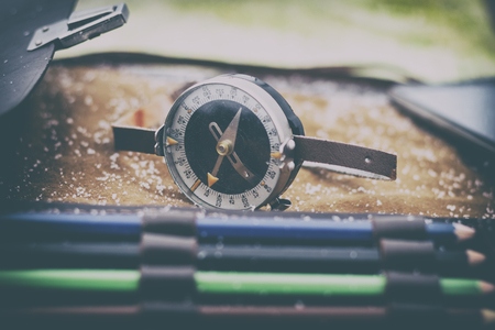 close-up. shallow depth of field. compass in focus. multi-colored pencil no focus. there is toning. 写真素材