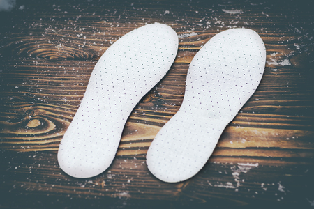 Breathable insoles for shoes on wooden background. have toning. Stock Photo