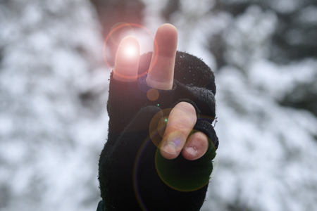 hand gesture, victory sign. the hand is in the mitten. shallow depth of cut. there is toning.