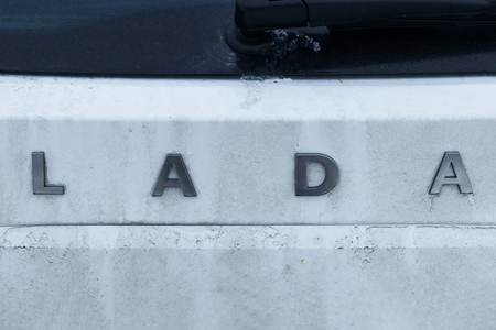 Minsk. Belarus. January 13, 2019. on the car of white color inscription Lada. the car is not quite clean there is dirt on the label. Stok Fotoğraf