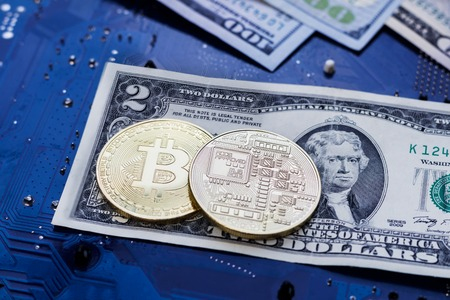 two coins bitcoin lie on two bucks. Bitcoin drop to such a low price. collapse failure. Stock Photo