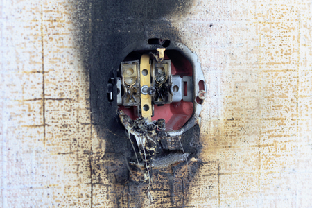 socket on fire. he is extinguished. plastic melted. bare wires Stok Fotoğraf