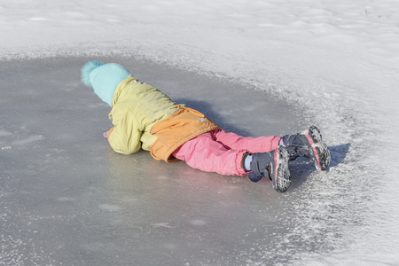 winter, icy. baby fell. face down. I can not get up. wounded injury Reklamní fotografie