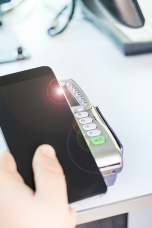 Buyer, payment through the POS terminal. mobile phone as a bank card. there is toning.