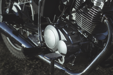 motorcycle. the main part of the engine. there is dirt on it. close-up. there is toning