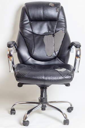 leather office chair on a white background. no isolation. repairs. hauling upholstery