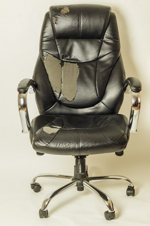 leather office chair on a white background. no isolation. repairs. hauling upholstery.