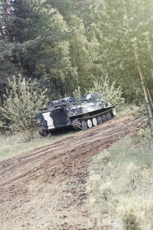 forest. worth infantry fighting vehicle. road share of military equipment. have toning Stock Photo