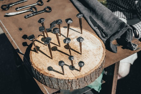 finished goods. the blacksmith forged a nail. close-up. Zdjęcie Seryjne