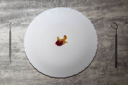 concept. rise in price of medical services. the plate in it is a stone from apricot. near the stomatological zerkolo. 스톡 콘텐츠 - 129311963
