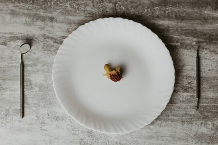 concept. rise in price of medical services. the plate in it is a stone from apricot. near the stomatological zerkolo.