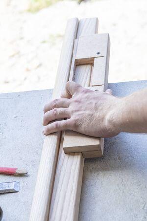 worker cuts the door hinge, milling cutter