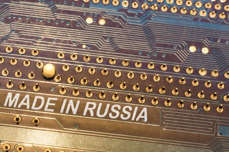 close-up. motherboard in blue. the inscription is made in Russia 写真素材 - 132078268