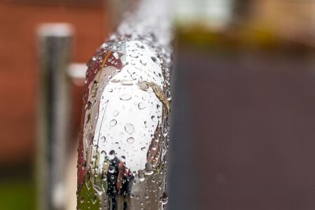 street lighting. its raining. metal perryl in drops of water. Stok Fotoğraf