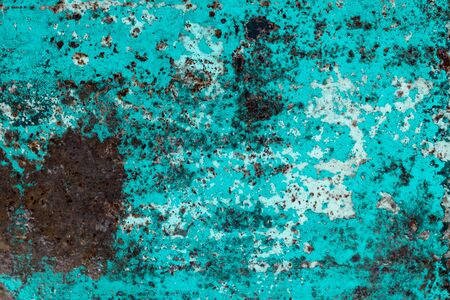 a sheet of metal was coated with paint then painted a different color. time destroyed the coating appeared rust. tectura Stock Photo