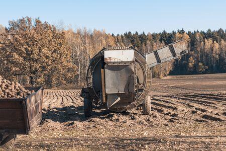 autumn. harvesting potatoes special harvesting machine Stock Photo