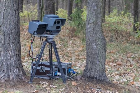 speed camera is standing in the forest. shallow depth of field. there is tinting. 版權商用圖片