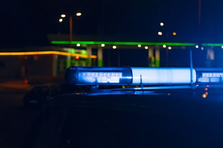 night time. blue police car with selective focus and blur bokeh