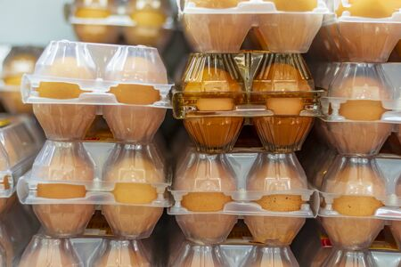 small shop. close-up. the egg is laid in a transparent plastic box