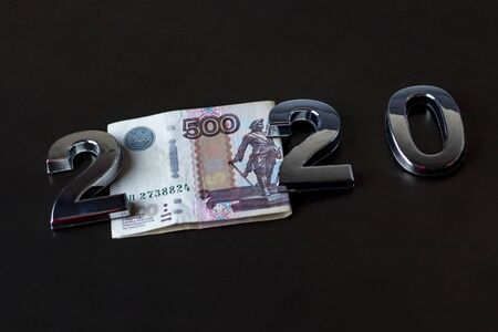 close-up. Black background. on it are numbers 2020 and a bill of 500 rubles. Russia. 写真素材