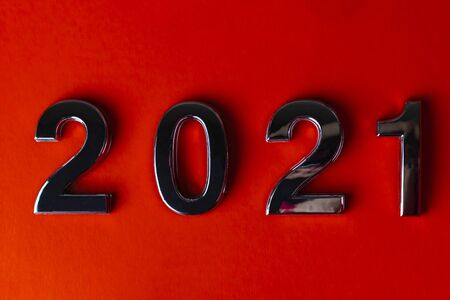 orange background. close-up. the laid out numbers 2021. metallic luster