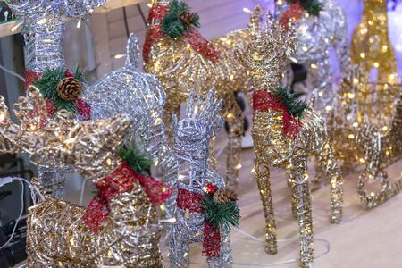 close-up. a toy made of wire and strewn with sparkles, inside a garland. holiday symbol 写真素材