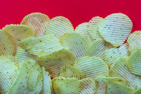 texture, background in red. chips laid out on it 写真素材
