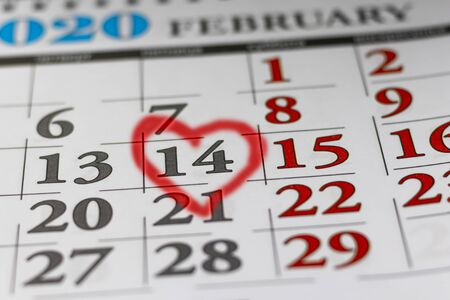 Valentine's Day 14 is marked on the calendar with a heart in red. Vacation concept.