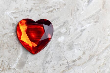 background of white marble. Red heart. Close-up. copy space