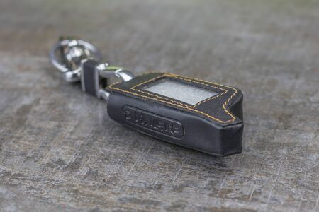 Car alarm cover. Made of leather and stitched with threads there is a ring to hang with keys.