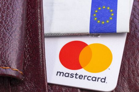 Minsk. Belarus. January 30, 2020 Wood background Bank card Close-up MasterCard Editorial
