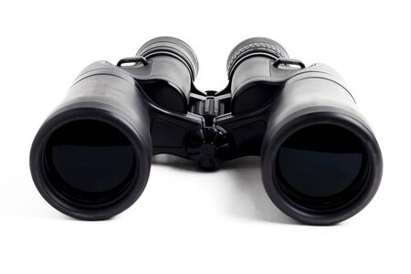 modern binoculars in black on a white background. Lenses forward. Close-up. There is no isolation.