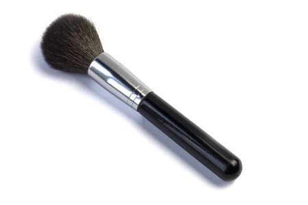 large makeup brush. Black color. On a white background, close-up. No insulation