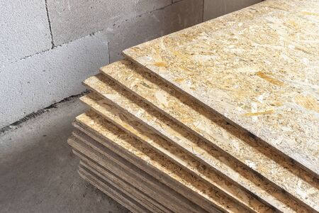 OSB slab building material made from reborn sawdust. They are stacked. Close-up. 写真素材 - 142732545