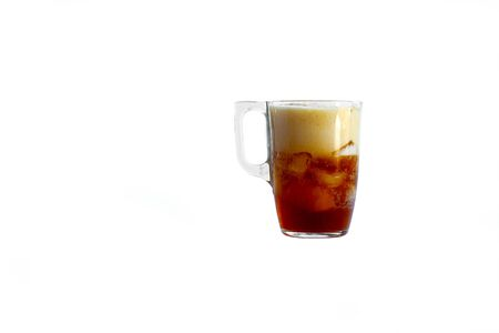 a mug is poured into it. Added ice cubes. Close-up. Deign on a white background.