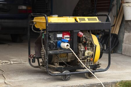 stand-alone diesel generator to supply electricity in an emergency. Yellow color. Serves not a large residential building.