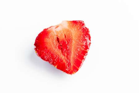 Shot on a white background. Juicy red strawberries. The cut in half. Close-up Stock Photo