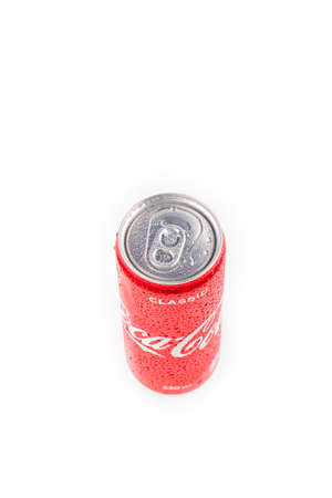 Minsk. Belarus. October 23, 2020. Studio lighting. A red metal can of Coca-Cola is covered with crayons of water. Chilled. On white background