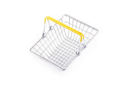 studio lighting. toy metal basket for products. On white background. Close-up