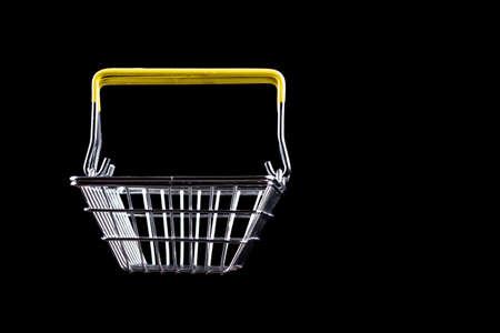 studio lighting. metal baby basket on a black background. Close-up Stock Photo