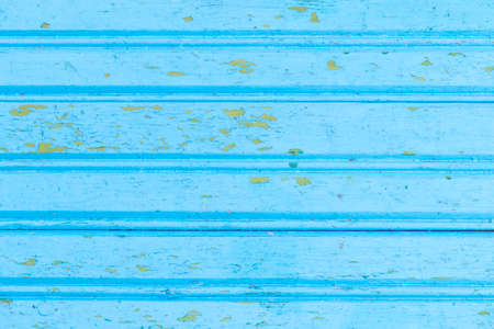 Daylight. The wooden background is painted blue because of old age the paint has peeled off. Retro, vintage. Lining