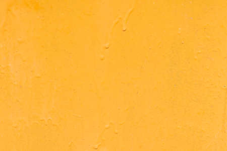 Daylight. A piece of rolled metal is painted yellow. Under the influence of sunlight, the paint faded