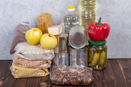 studio lighting. set of products. Cereals, canned food in metal cans. Concept, subsidy of a necessary set of food for life.products, subsidies